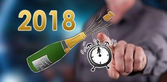 Sirva el Año Nuevo conmovedor 2018 en una pantalla táctil Foto de archivo