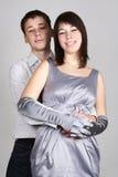 Sirva el abarcamiento de la mujer en vestido de noche de la parte posterior Imagen de archivo libre de regalías
