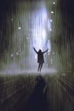 Sirva el aumento de los brazos en la lluvia en la noche Imagenes de archivo