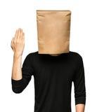sirva el recubrimiento de su cabeza usando una bolsa de papel Imagen de archivo
