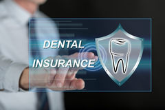 Sirva el tacto de un concepto del seguro dental en una pantalla táctil Imagen de archivo