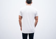 Sirva la camiseta y los tejanos en blanco que llevan en Foto de archivo libre de regalías