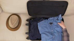 Sirva la ropa del embalaje del acabamiento en bolso del viaje almacen de metraje de vídeo