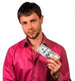 Sirva sostener 20 billetes de banco de los dólares de Estados Unidos aislados en un whi Imagen de archivo libre de regalías