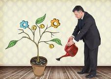Sirva sostener la regadera y el dibujo de los gráficos de negocio en ramas de la planta en la pared Imagenes de archivo