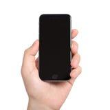 Sirva sostenerse en el gris aislado mano del espacio del iPhone 6 Fotos de archivo