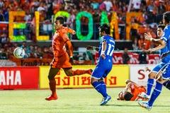 SISAKET THAILAND-AUGUST 13: David Bala of Sisaket FC. (orange) Royalty Free Stock Images