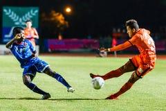 SISAKET THAILAND-AUGUST 13: David Bala of Sisaket FC. (orange) Royalty Free Stock Photo