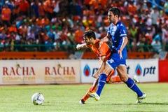 SISAKET THAILAND-AUGUST 13: Victor Amaro of Sisaket FC. (orange) Stock Images