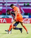 SISAKET THAILAND 3. AUGUST: Victor Amaro von Sisaket FC (Orange) Lizenzfreies Stockbild