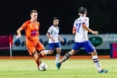 SISAKET THAILAND-JULY 23: Brent McGrath of Sisaket FC. (orange). In action during Thai Premier League between Sisaket FC and Songkhla Utd at Sri Nakhon Lamduan Stock Photos