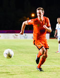 SISAKET THAILAND-JULY 13: Brent McGrath of Sisaket FC. (orange) Stock Images