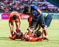 SISAKET THAILAND-JULY 23: First aid team of Sisaket FC. (blue). In action during Thai Premier League between Sisaket FC and Songkhla Utd at Sri Nakhon Lamduan Royalty Free Stock Photo