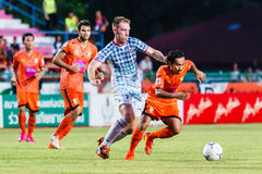 SISAKET THAILAND-JULY 6: Somsak Wongyai of Sisaket FC. (orange) Stock Photography