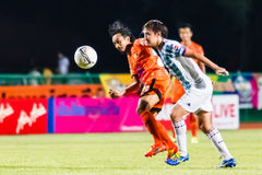 SISAKET THAILAND-JULY 6: Somsak Wongyai of Sisaket FC. (orange) Royalty Free Stock Photography