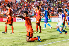 SISAKET THAILAND-JUNE 21: Eakkapan Nuikhao of Sisaket FC. (orange) Royalty Free Stock Images