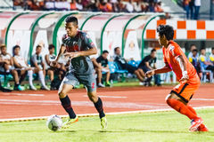 SISAKET THAILAND-JUNE 29: Ekkachai Sumrei of Bangkok Utd. (grey) Stock Photo