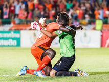 SISAKET THAILAND-JUNE 8: Godwin Antwi of Sisaket FC. (orange) Stock Photo
