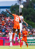 SISAKET THAILAND-JUNE 8: Godwin Antwi of Sisaket FC. (orange) Royalty Free Stock Photos