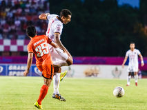 SISAKET THAILAND-JUNE 8: Jay Bothroyd of Muangthong Utd. (white) Royalty Free Stock Photo