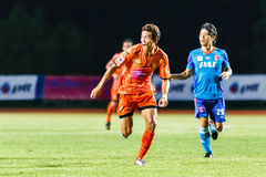 SISAKET THAILAND-JUNE 21: Santirat Viang-in (orange) of Sisaket FC. Royalty Free Stock Images
