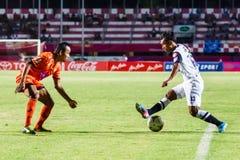 SISAKET THAILAND-MAY 28: Anuwat Nakkasem of Chonburi FC. (white). In action during Thai Premier League between Sisaket FC and Chonburi FC at Sri Nakhon Lamduan Royalty Free Stock Image