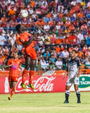 SISAKET THAILAND-MAY 28: Godwin Antwi of Sisaket FC. (orange) Royalty Free Stock Photos