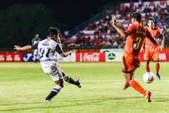 SISAKET THAILAND-MAY 28: Nurul Sriyankem of Chonburi FC. (white) Royalty Free Stock Images