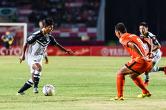 SISAKET THAILAND-MAY 28: Nurul Sriyankem of Chonburi FC. (white) Royalty Free Stock Photo