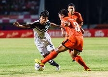 SISAKET THAILAND-MAY 28: Nurul Sriyankem of Chonburi FC. (white) Royalty Free Stock Image