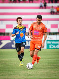 SISAKET THAILAND-MAY 21: Victor Amaro of Sisaket FC. (orange) in Stock Image