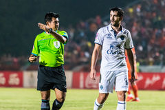 SISAKET THAILAND-OCTOBER 15: The referee (green). In action during Thai Premier League between Sisaket FC and Buriram Utd at Sri Nakhon Lamduan Stadium on stock photography