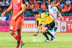SISAKET THAILAND-SEPTEMBER 20: The referee use the vanishing spr. Ay during Thai Premier League between Sisaket FC and TOT SC at Sri Nakhon Lamduan Stadium on stock images