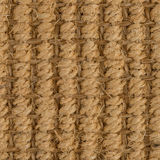 Sisal carpet. Closeup detail of a brown sisal carpet texture background royalty free stock photography