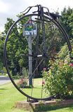 Sissinghurst, penny farthing sculpture and village sign Stock Photography