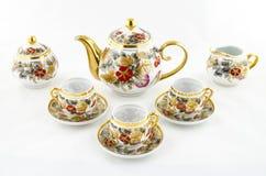 Sistema antiguo del té y de café de la porcelana con adorno de la flor Fotografía de archivo