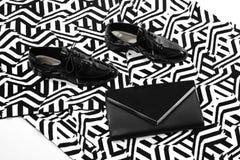 Sistema atractivo y de moda de accesorios blancos y negros del encanto Imagen de archivo libre de regalías
