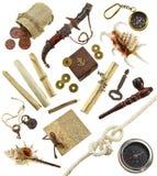 Sistema aventurero con los objetos del pirata y del detective Imágenes de archivo libres de regalías