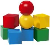 Sistema coloreado de bolas y de juguetes de los cubos Fotografía de archivo libre de regalías