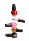 Sistema colorido del esmalte de uñas en el fondo blanco aislado Fotografía de archivo