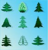 Sistema de árboles de navidad en un fondo azul Fotos de archivo libres de regalías