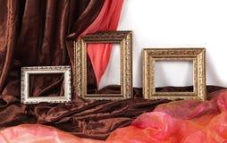 Sistema de bastidores del vintage en fondo de la materia textil Fotos de archivo libres de regalías