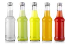 Sistema de botellas con la bebida sabrosa fotos de archivo libres de regalías