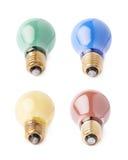 Sistema de bulbos eléctricos que mienten en lado, aislado sobre el fondo blanco foto de archivo