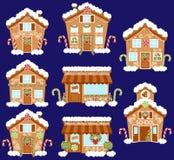 Sistema de casas de pan de jengibre lindas del día de fiesta del vector, de tiendas y de otros edificios stock de ilustración