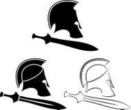 Sistema de cascos antiguos con las espadas Imágenes de archivo libres de regalías