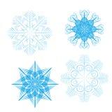 Sistema de 4 copos de nieve detallados del vector ilustración del vector