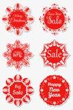 Sistema de copos de nieve festivos de las etiquetas engomadas con el texto Libre Illustration
