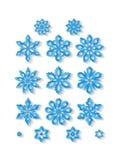 Sistema de copos de nieve tallados aislados en el fondo blanco Foto de archivo libre de regalías
