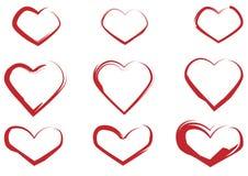 Sistema de corazones rojos pintados con un cepillo ilustración del vector